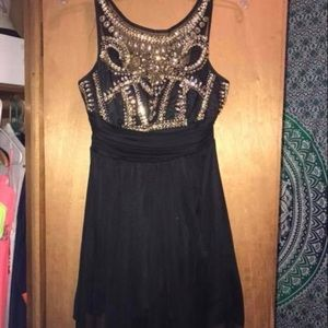 Black and gold sequin homecoming dress